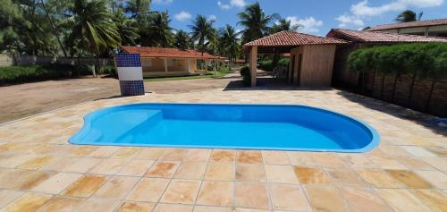 The swimming pool at or near Condomínio Village, Casa Cecília