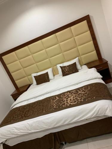 Cama ou camas em um quarto em Aldura al raqya