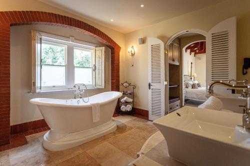 A bathroom at Franschhoek Country House & Villas
