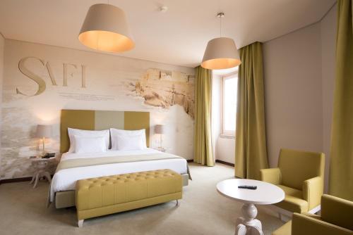 Uma cama ou camas num quarto em Vila Gale Collection Elvas