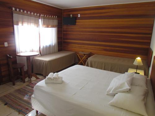A bed or beds in a room at Pousada La Vivienda