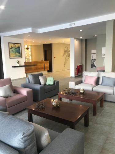 A seating area at MASSOURI BEACH HOTEL