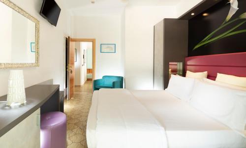 Letto o letti in una camera di Hotel Castellucci
