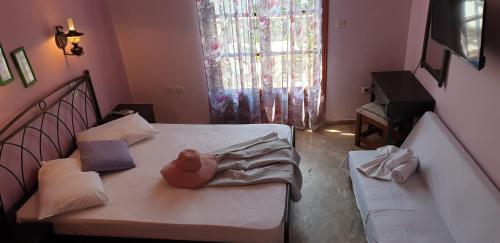 Ένα ή περισσότερα κρεβάτια σε δωμάτιο στο Ilios Apartments