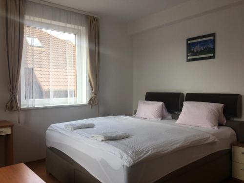 Кровать или кровати в номере Penzion Relax Martina