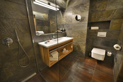 A bathroom at Grand Hotel Hradec
