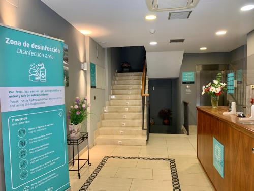 The lobby or reception area at Hotel Los Templarios