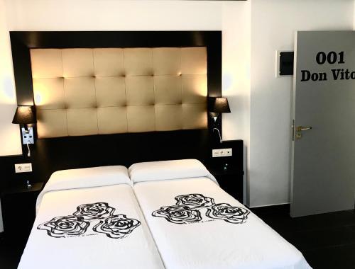 Cama o camas de una habitación en Guest House El Padrino