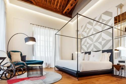 A bed or beds in a room at One Shot Palacio Conde de Torrejón 09