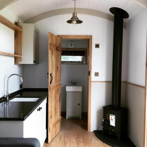 A kitchen or kitchenette at Astwell Mill Luxury Shepherds Hut