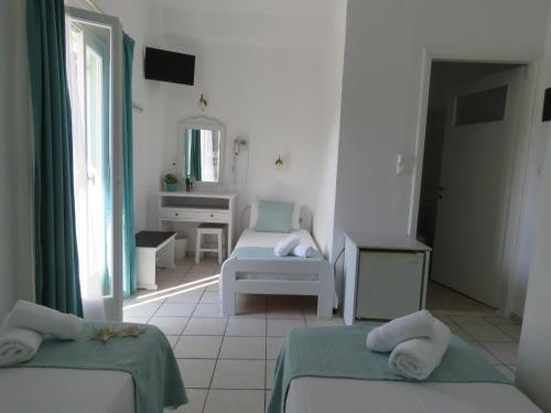 A bed or beds in a room at Corali Hotel Beach Front Property