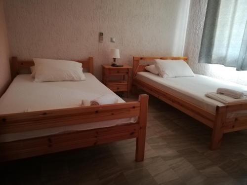 Ένα ή περισσότερα κρεβάτια σε δωμάτιο στο Angelos Κandia Apartments