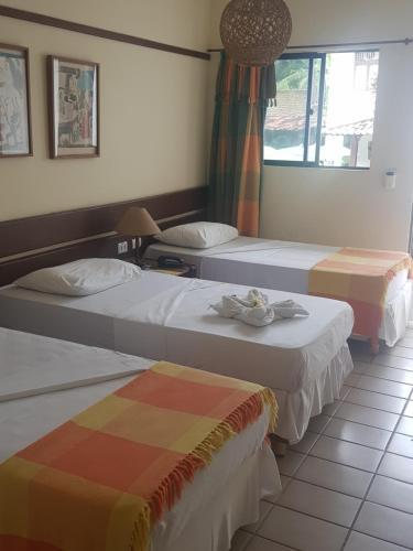 Cama ou camas em um quarto em Hotel Pousada São Francisco