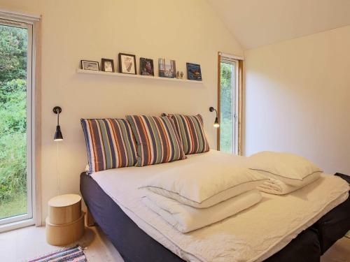 Ein Bett oder Betten in einem Zimmer der Unterkunft Holiday home Nykøbing Sj XXIV
