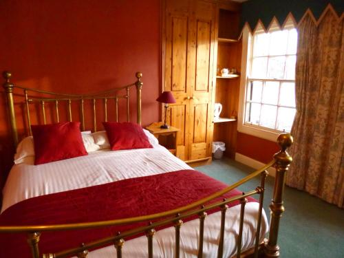 A bed or beds in a room at The Ferry Boat Inn
