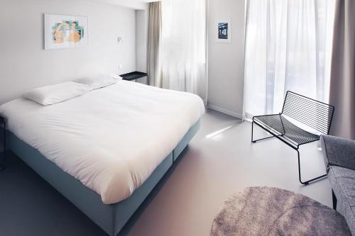 A bed or beds in a room at 171. Urban Design Hotel
