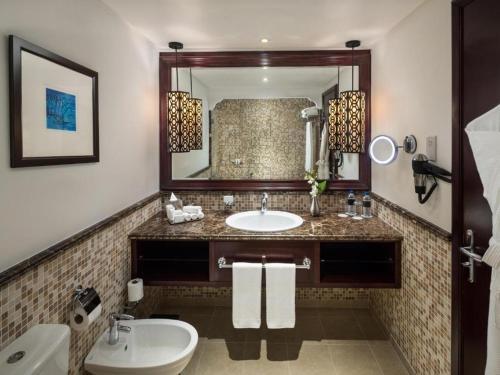 A bathroom at Ajman Hotel
