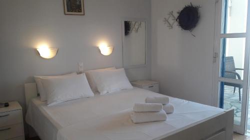 Ένα ή περισσότερα κρεβάτια σε δωμάτιο στο Vrahos Studios