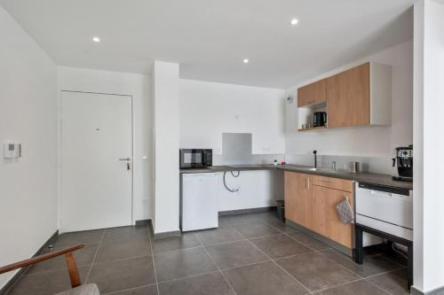 A kitchen or kitchenette at Modern 1br w AC & terrace in the heart of Joliette in Marseille Welkeys