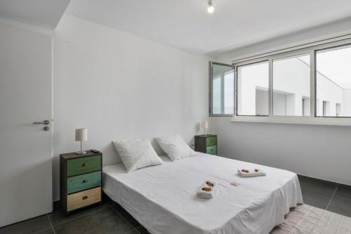 A bed or beds in a room at Modern 1br w AC & terrace in the heart of Joliette in Marseille Welkeys