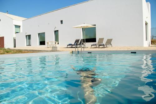 The swimming pool at or near Torre de Palma Wine Hotel - Design Hotels