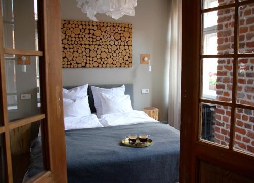 Łóżko lub łóżka w pokoju w obiekcie Apartamenty Luizjana