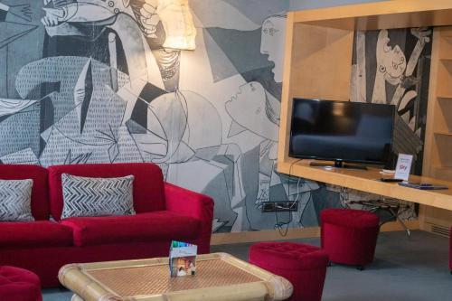 Télévision ou salle de divertissement dans l'établissement Hotel Abitart