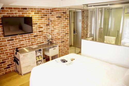 Tempat tidur dalam kamar di Shibuya Hotel En