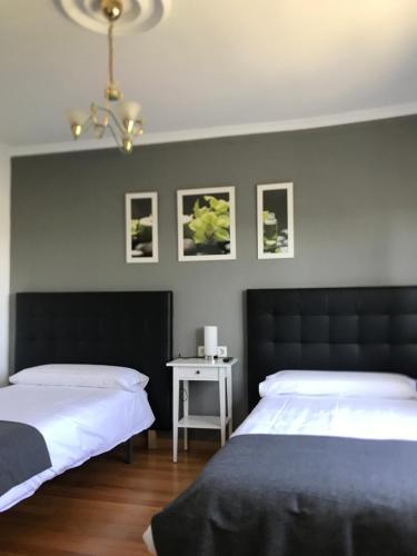 Cama o camas de una habitación en Pensión Albergue A Pedra