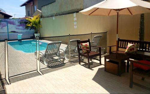 The swimming pool at or near Pousada Recanto do Cowboy