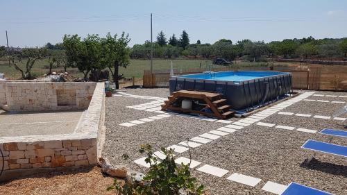 A view of the pool at I Trulli Di Nonno Giovanni or nearby