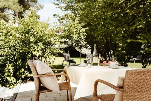 Ein Restaurant oder anderes Speiselokal in der Unterkunft Hotel Reindl Suiten & Appartments