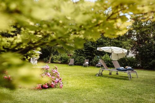 Ein Garten an der Unterkunft Hotel Reindl Suiten & Appartments
