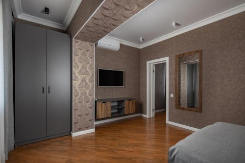 A television and/or entertainment centre at Akropol Apartments