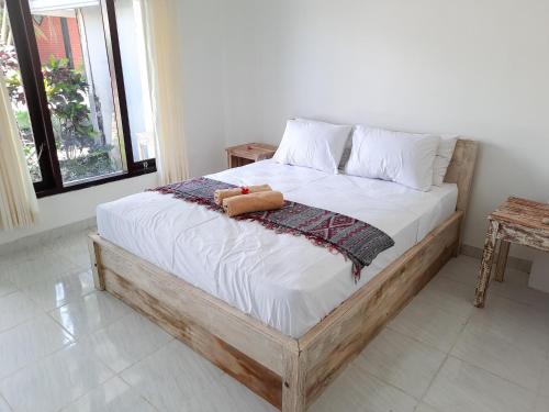 Cama o camas de una habitación en Merta Sari Bingin Bungalows