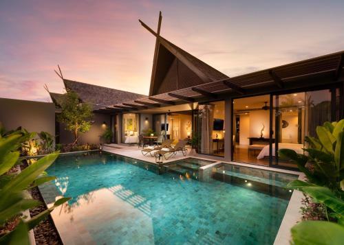 Der Swimmingpool an oder in der Nähe von Anantara Vacation Club Mai Khao Phuket - SHA Plus
