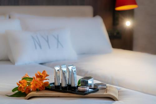 A bed or beds in a room at NYX Hotel Bilbao by Leonardo Hotels