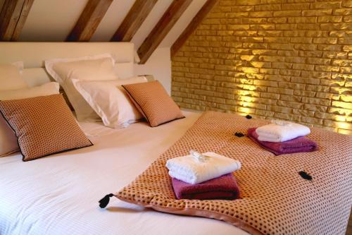 Un ou plusieurs lits dans un hébergement de l'établissement Grand Duplex Ribeauvillé - LES HYDRANGEAS