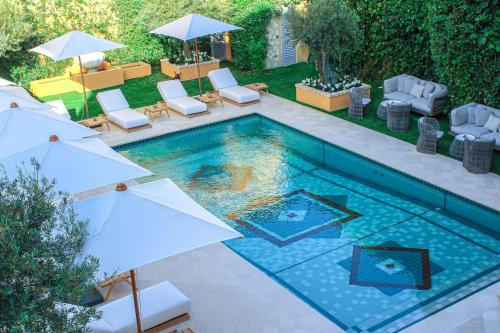A view of the pool at Pan Dei Palais or nearby
