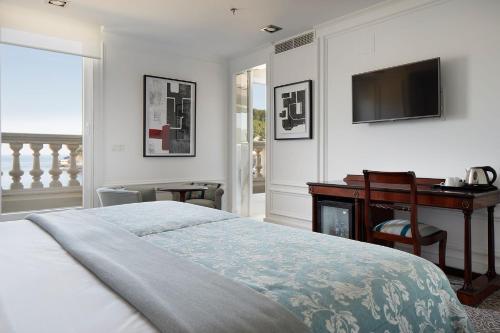 Een bed of bedden in een kamer bij Hotel de Londres y de Inglaterra