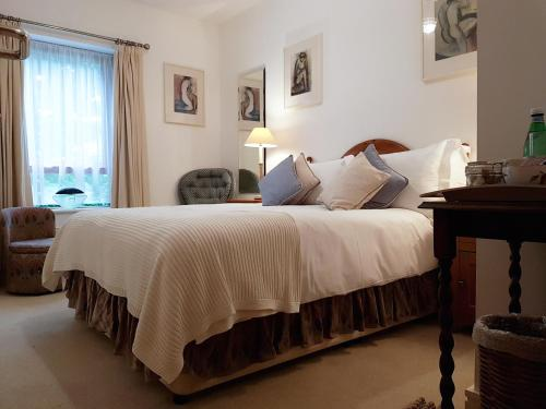 A bed or beds in a room at Chy Bre