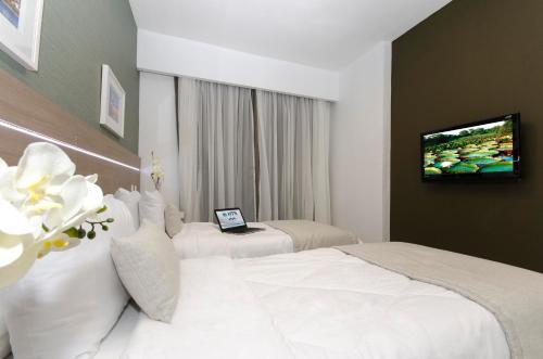 Cama o camas de una habitación en Hotel Adrianópolis All Suites