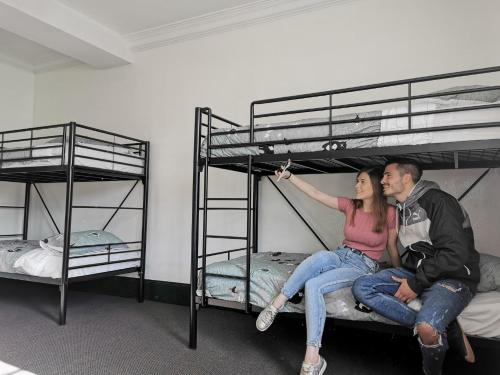 A bunk bed or bunk beds in a room at Elephant Backpacker
