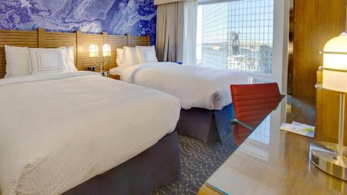 A bed or beds in a room at Fairfield Inn by Marriott New York Manhattan/Financial District