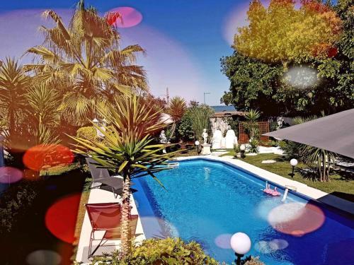 The swimming pool at or close to VILLA HÉLÈNE-SUITE Junior- MONTPELLIER AÉRÉOPORT PARC EXPO-ARENA-MER