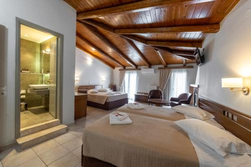 A bed or beds in a room at Parnassos Delphi Hotel
