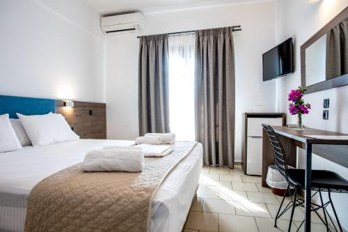Ένα ή περισσότερα κρεβάτια σε δωμάτιο στο Maria's House Hotel