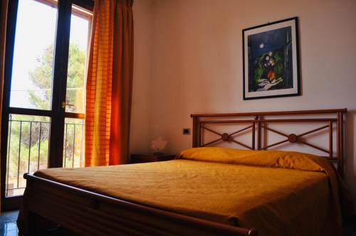 A bed or beds in a room at Case Vacanza Vivaldi