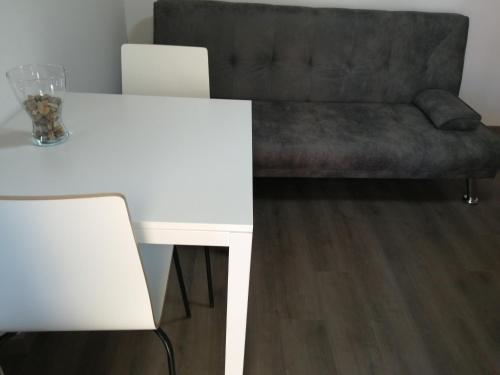 A seating area at Apartamento A Fabrica