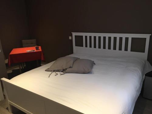 Een bed of bedden in een kamer bij Break@Bruges
